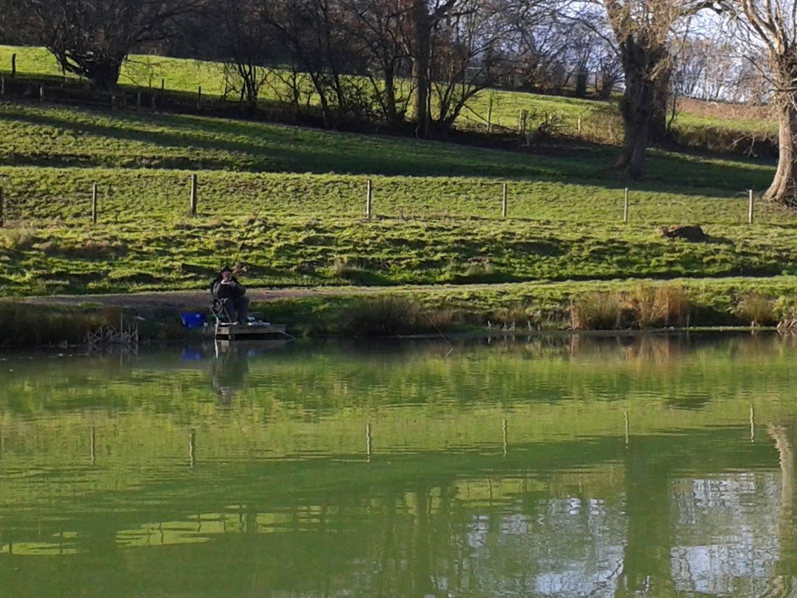 Dad catching perch at Harescombe Fishery Meadow Lake